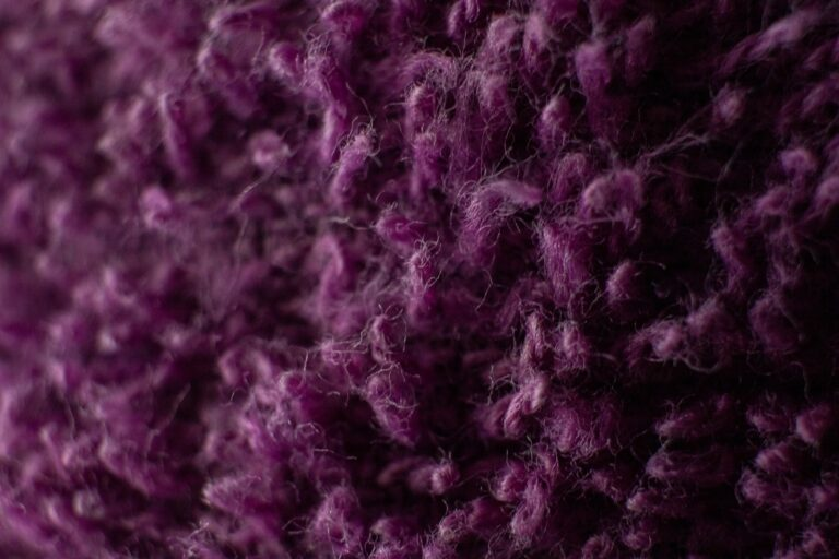 purple and white knit textile